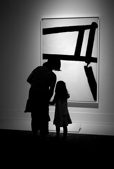 Mother and child in front of a Franz Kline painting at the Art Gallery of Ontario's