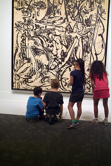 Children figuring out a Jackson Pollock painting at the Art Gallery of Ontario's